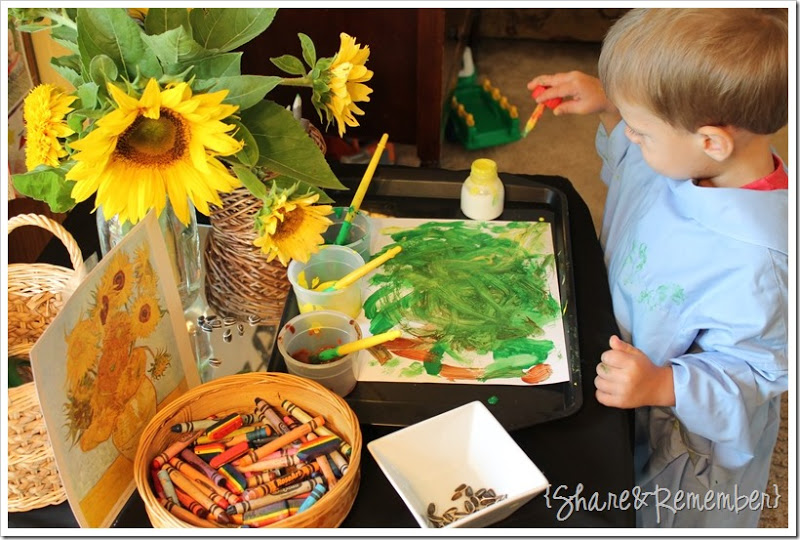boy sitting at table painting learning how to play and explore as part of ispirational quotes